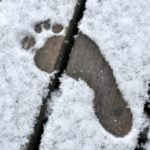 bare-footprint-in-first-winter-snow